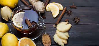 Cup of Ginger tea with lemon and honey on dark brown wooden  bac. Kground, top view, copy space Royalty Free Stock Image