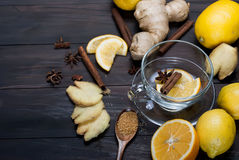 Cup of Ginger tea with lemon and honey on dark brown wooden  bac. Kground, top view, copy space Royalty Free Stock Images