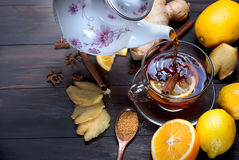 Cup of Ginger tea with lemon and honey on dark brown wooden  bac Royalty Free Stock Image