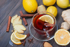 Cup of Ginger tea with lemon and honey on dark brown wooden  bac Stock Images