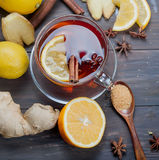 Cup of Ginger tea with lemon and honey on dark brown wooden  bac. Kground, top view, copy space Royalty Free Stock Photo