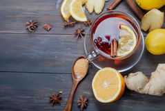 Cup of Ginger tea with lemon and honey on dark brown wooden  bac. Kground, top view, copy space Royalty Free Stock Photography
