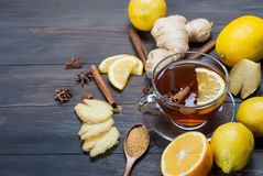 Cup of Ginger tea with lemon and honey on dark brown wooden  bac. Kground, top view, copy space Stock Photography