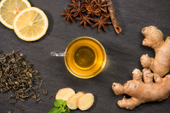 Cup of ginger tea with lemon and honey on dark stone background Royalty Free Stock Image