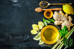 Cup of ginger tea. With lemon and honey on slate plate stock photography