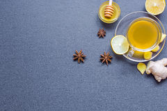 Cup of ginger tea with lemon, honey and spices Royalty Free Stock Images