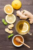 Cup of ginger tea with lemon and honey on wooden background Stock Photos