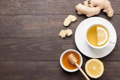 Cup of ginger tea with lemon and honey on wooden background. Cop Stock Image