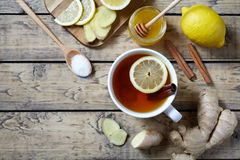 Cup of ginger tea with lemon and honey on wooden background. Top view. Antiviral useful Healthy drink Royalty Free Stock Photos