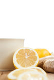 Cup of ginger tea with lemon isolated on white Stock Image