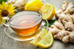 Cup of ginger tea. With lemon on wooden table royalty free stock photos