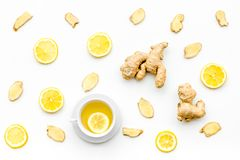 Cup of ginger tea near ginger root on white background top view pattern. Cup of ginger tea near ginger root on white background top view royalty free stock photos