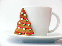 Cup with gingerbread. Close up of the white cup with gingerbread - Christmas tree on the white background royalty free stock photos