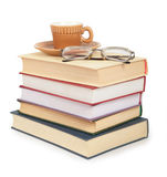 Cup and glasses on pile of book Royalty Free Stock Image