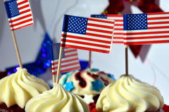 Cup of glazed cupcakes or muffins decorated with ameri stock image