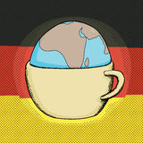 Cup with Globe and German Flag Royalty Free Stock Photography