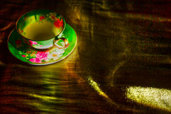 Cup gold background Stock Images
