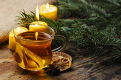 Cup of golden tea in evening candle light. Stock Image