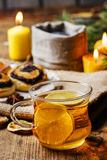 Cup of golden tea in evening candle light Stock Photography