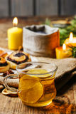 Cup of golden tea in evening candle light Royalty Free Stock Images
