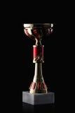cup Goldener Cup des Siegers auf schwarzem Hintergrund Stockbilder