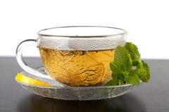 Cup grüner Tee mit Zitrone und Minze Lizenzfreie Stockbilder