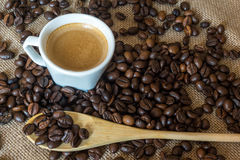 Cup and grain of coffee Royalty Free Stock Image