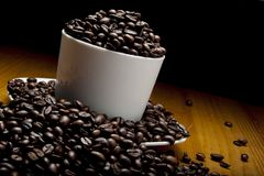 Cup of grains of coffee. In diagonal orientation for dinamic ilustration royalty free stock photo