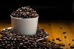 Cup of grains of coffee. Representative of hight levels of caffeine stock image
