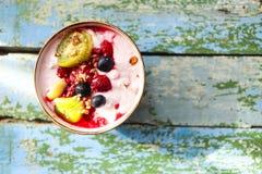 Cup of granola with yogurt and fruit Stock Photos