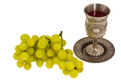 Cup and grape Stock Images