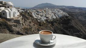 Cup of Greek Coffee. Greek Coffee served on a white cup on a table outside a coffee shop in Santorini, Greece Stock Photos