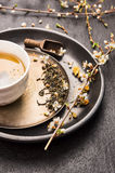 Cup of green Chinese Tea with fresh cherry blossoms Stock Photography