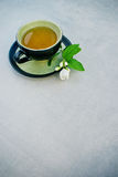 Cup of green jasmine tea Stock Photos