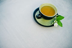 Cup of green jasmine tea Royalty Free Stock Photos