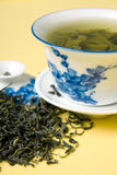 Cup of green tea. Clay cup with green tea and tea leaves in dried tea leaves Stock Images