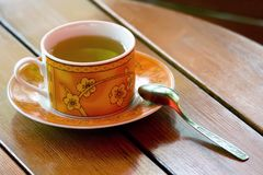 Cup of green tea. On a table Royalty Free Stock Images