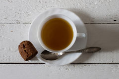 Cup of green tea and biscuit Royalty Free Stock Photo