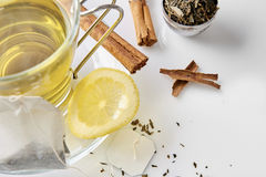 Cup of green tea with cinnamon and lemon top view Stock Image