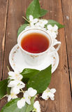 Cup with green tea and colors of jasmin Royalty Free Stock Images