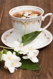 Cup with green tea and colors of jasmin Stock Photography