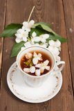 Cup with green tea and colors of jasmin Royalty Free Stock Image