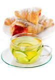 Cup of green tea and croissants Stock Image