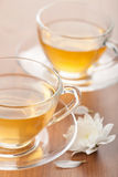 Cup of green tea and flower Royalty Free Stock Photography