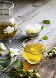 Cup of green tea infused with jasmine on a gray wooden background Royalty Free Stock Photography