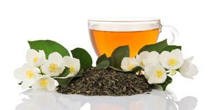 Cup of green tea with jasmine flowers Royalty Free Stock Photo