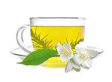 Cup of green tea with jasmine flowers royalty free stock image