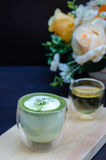 Cup of green tea latte Stock Image