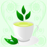 Cup of green tea with leaves Stock Photo