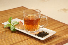 Cup with green tea and leaves Stock Image
